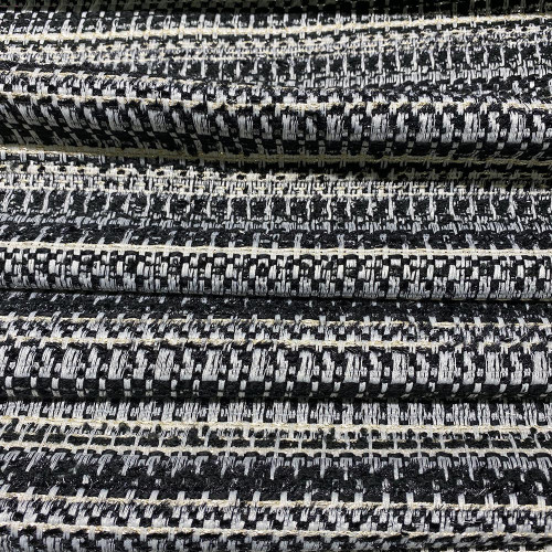 Tissu tissé et irisé effet tweed noir ivoire et or