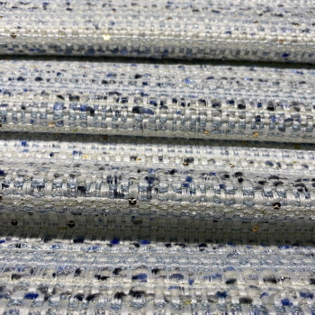 Woven and iridescent fabric with blue tweed and sequins
