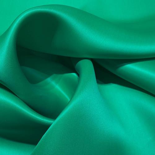 Emerald green silk triple organza fabric