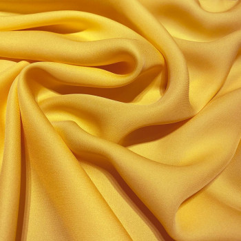 Yellow fluid silk crepe dobby fabric