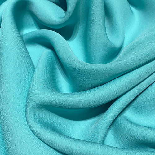 Aqua blue fluid silk crepe dobby fabric