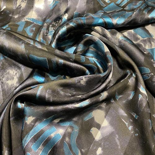 Tissu mousseline de soie imprimé bande satin motifs géométriques
