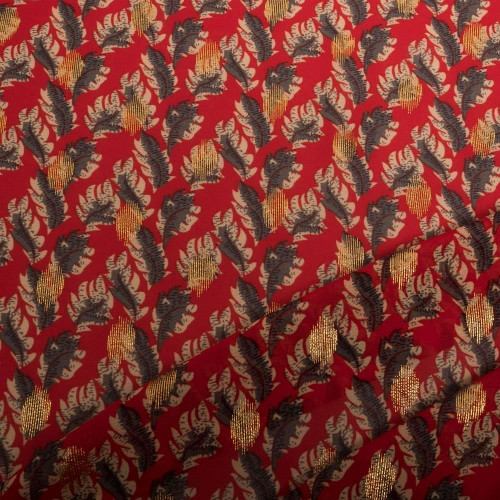 Tissu mousseline crêpe rouge et feuilles or