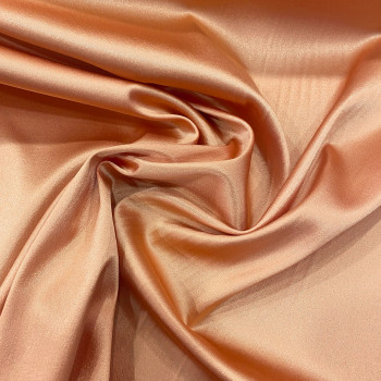 Tissu caddy crêpe envers satin stretch rose abricot