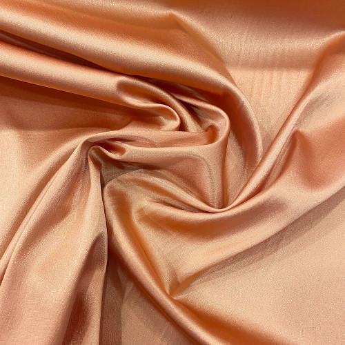 Tissu caddy crêpe envers satin stretch rose abricot