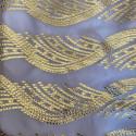 Metallic silk jacquard on a lilac gold chiffon background