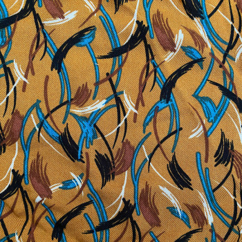 Twill fabric with feathers print on ochre background 100% viscose