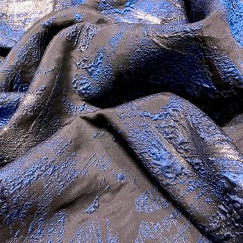 Royal blue silk brocade fabric on navy blue