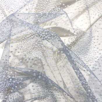 Tulle pailleté constellation floqué ivoire bleu-gris sur tulle bleu