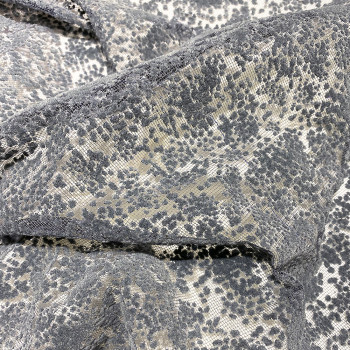 Tulle pailleté empreinte floquée gris parsemé de paillettes sur fond gris