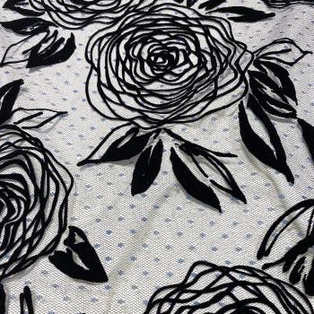 Sequined tulle black flocked flower on navy blue plumetis tulle