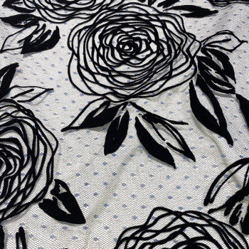 Tulle pailleté fleur floquée noir sur tulle plumetis bleu marine