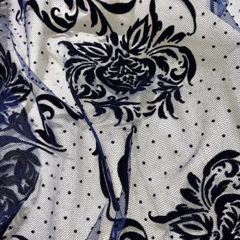 Tulle fleurs floquées sur tulle à pois bleu