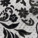 Tulle pailleté fleurs floquées et pailletées or sur tulle plumetis noir