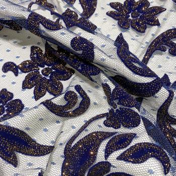 Tulle pailleté fleurs floquées et pailletées cuivre sur tulle plumetis bleu