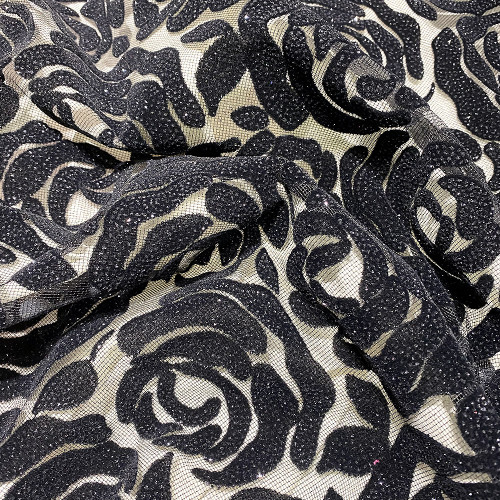 Tulle pailleté fleurs floquées et pailletées noir sur tulle noir