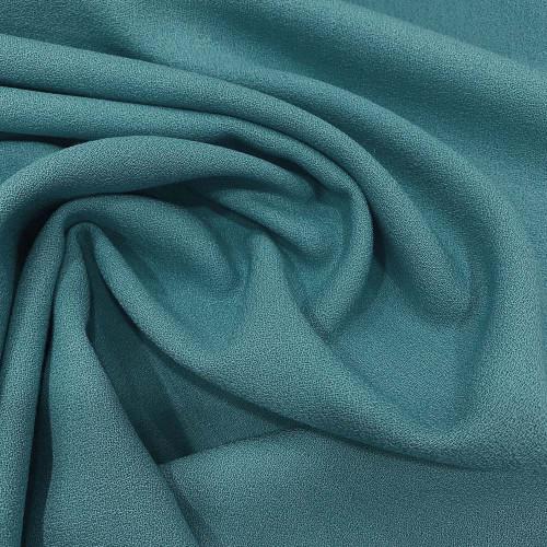 Tissu crêpe de laine 100% laine bleu océan