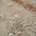 Tissu tulle brodé perlé nude