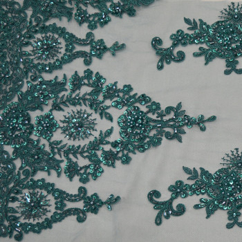Blue beaded and embroidered tulle fabric