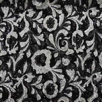 Tissu paillettes argent sur fond noir