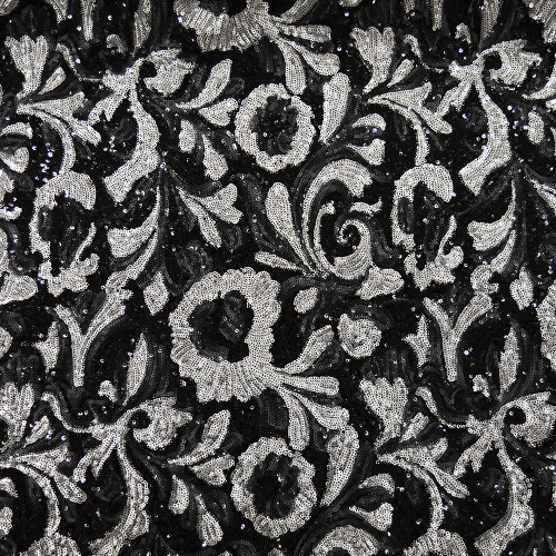 Silver sequins fabric on black background