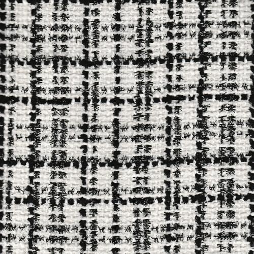 Tissu tissé et irisé effet tweed noir et blanc