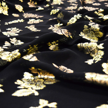 Gold metal silk jacquard fabric on black chiffon