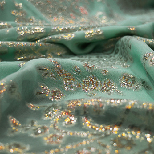 Metallic silk jacquard fabric with jade green chiffon background
