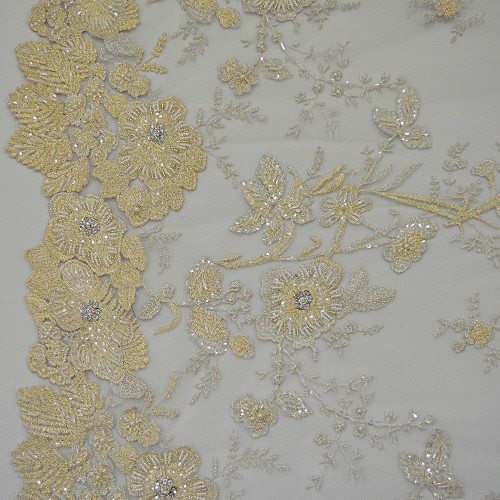 Embroidered tulle fabric gold